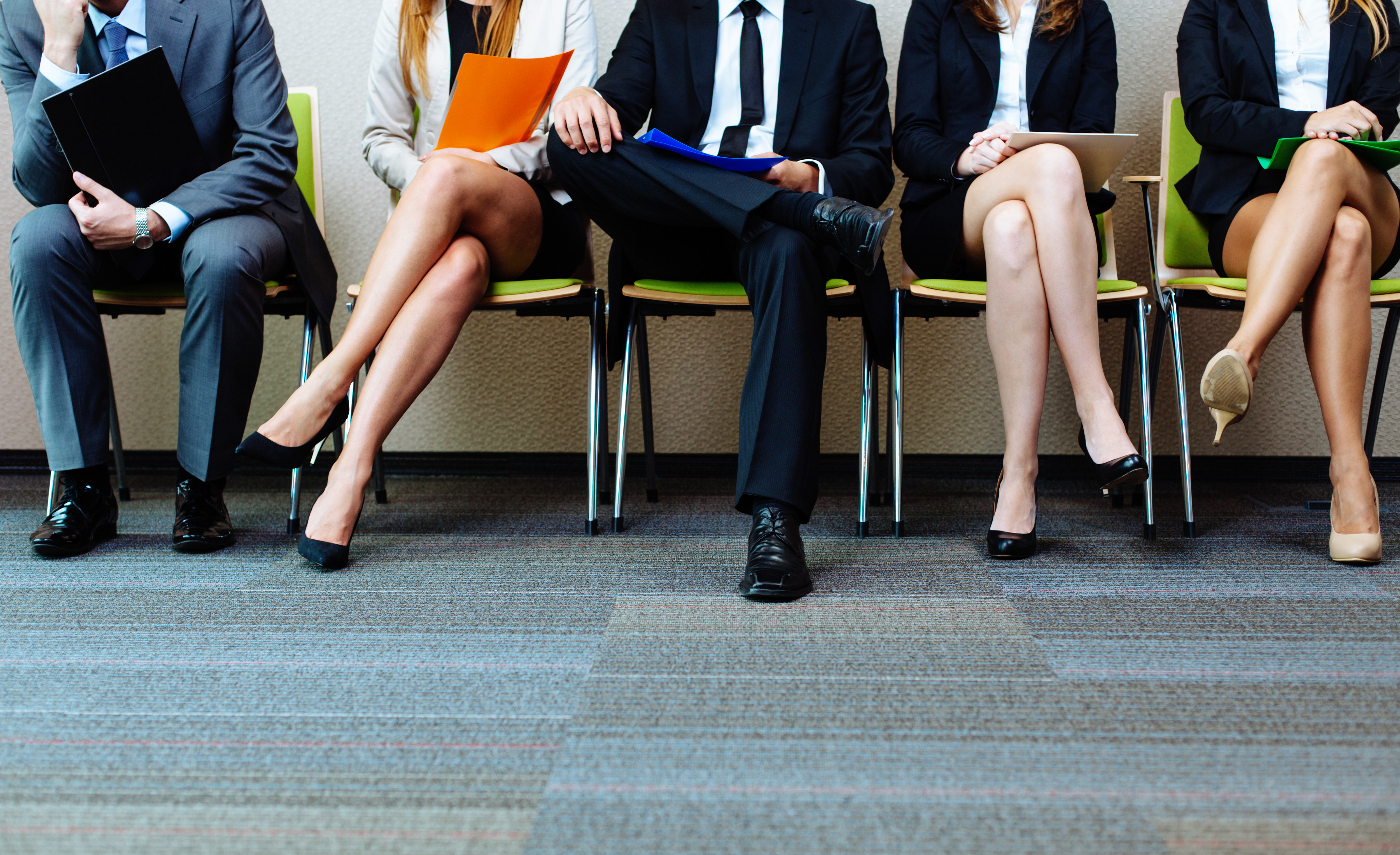 People sitting on chairs with their legs crossed - Upstart Personal Loans