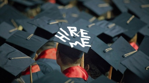 """College student with """"Hire Me"""" on his hat - Upstart Personal Loans"""