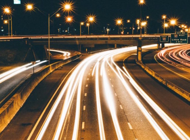 A freeway with car lights - Upstart Personal Loans