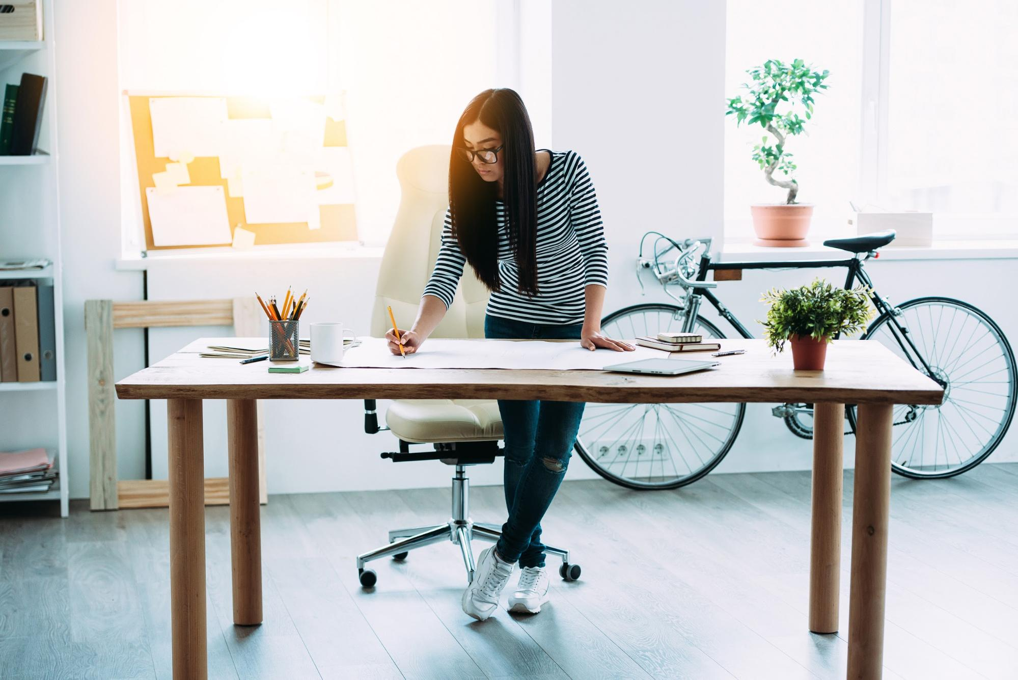Woman working at a table - Upstart Personal Loans