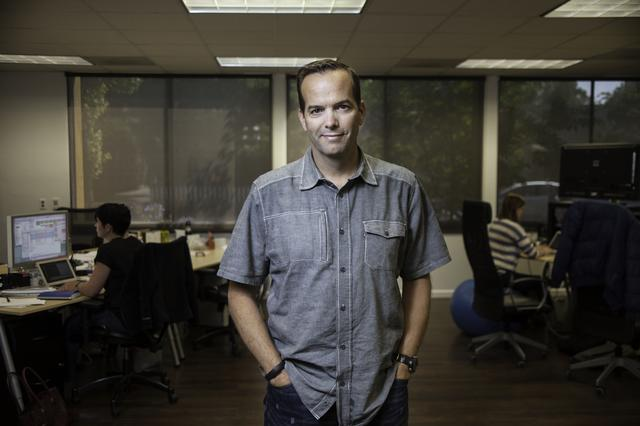 Man in collared shirt in an office - Upstart Personal Loans