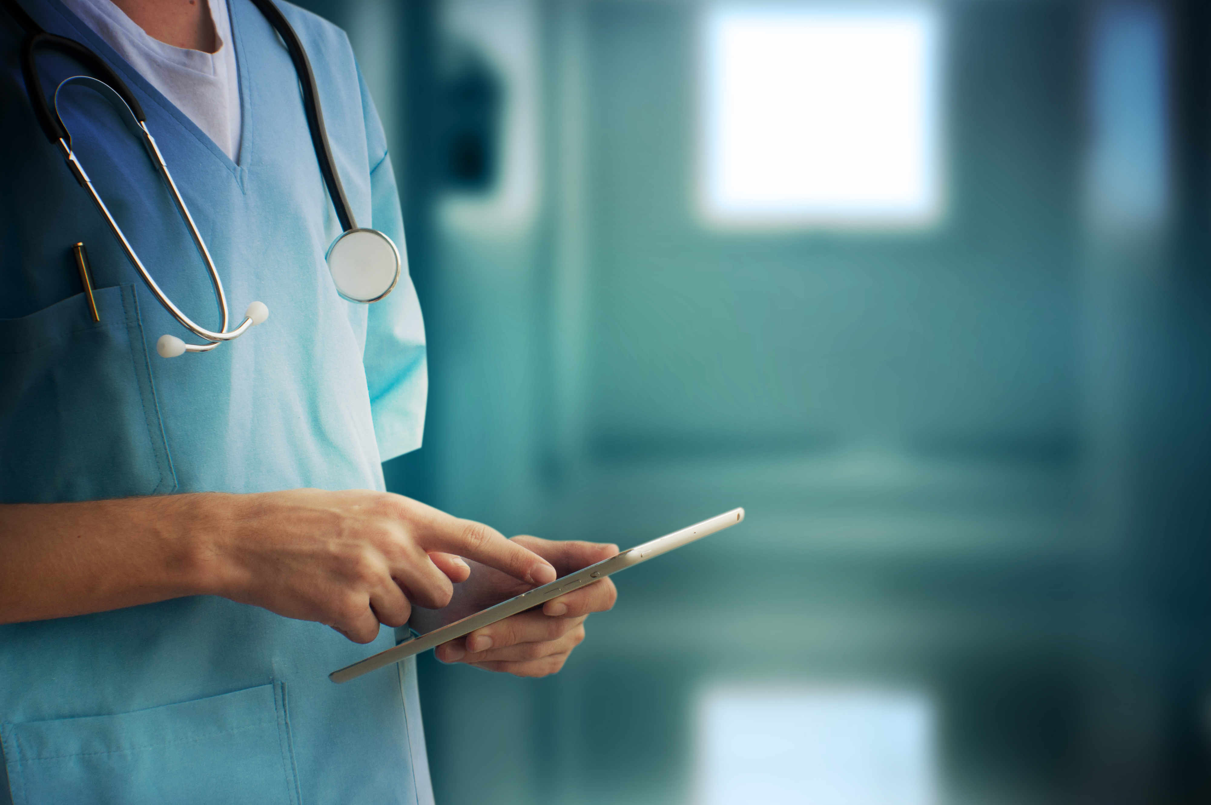 A doctor using a tablet - Upstart Personal Loans