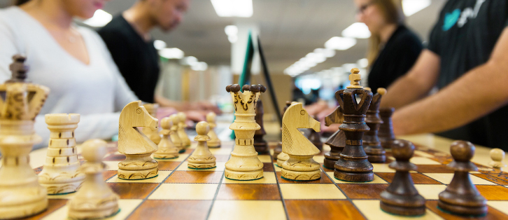 Chess board with chess pieces - Upstart Personal Loans