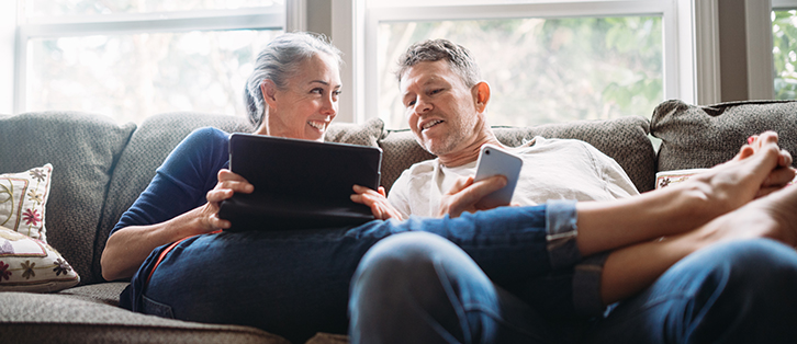 Older couple on a couch - Upstart Personal Loans