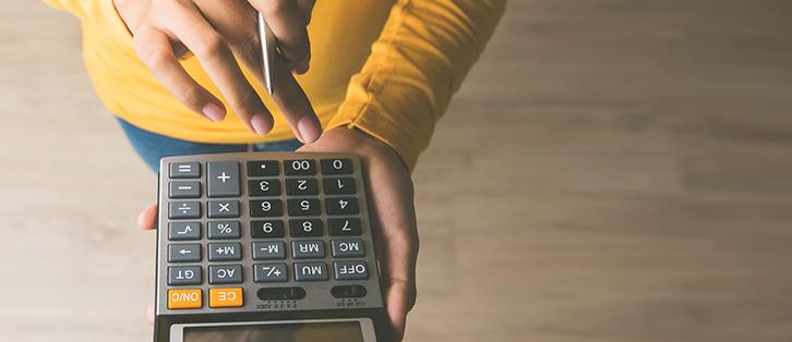 A person using a calculator - Upstart Personal Loans