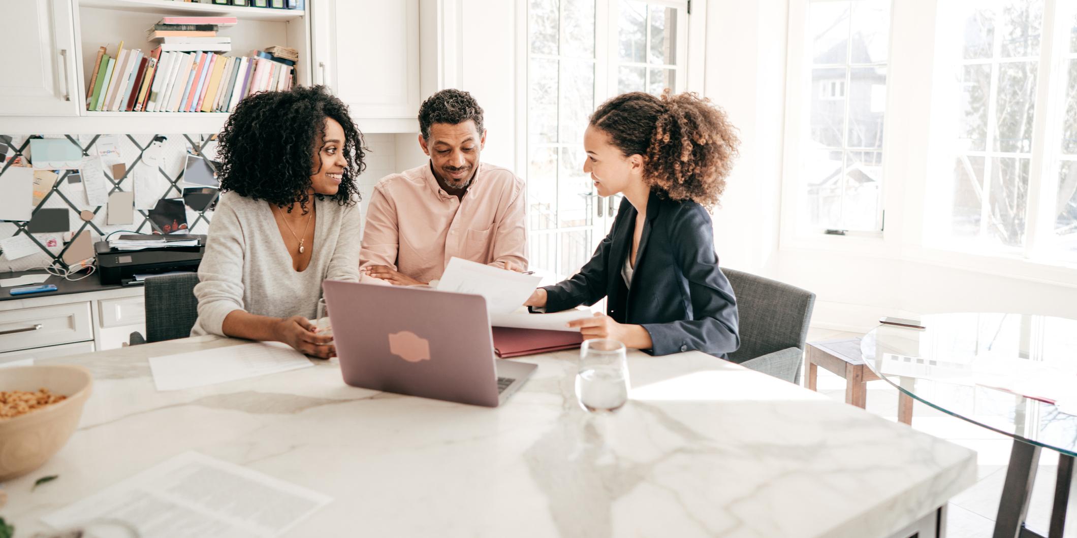 3 People Looking Over Paperwork - Upstart Personal Loans