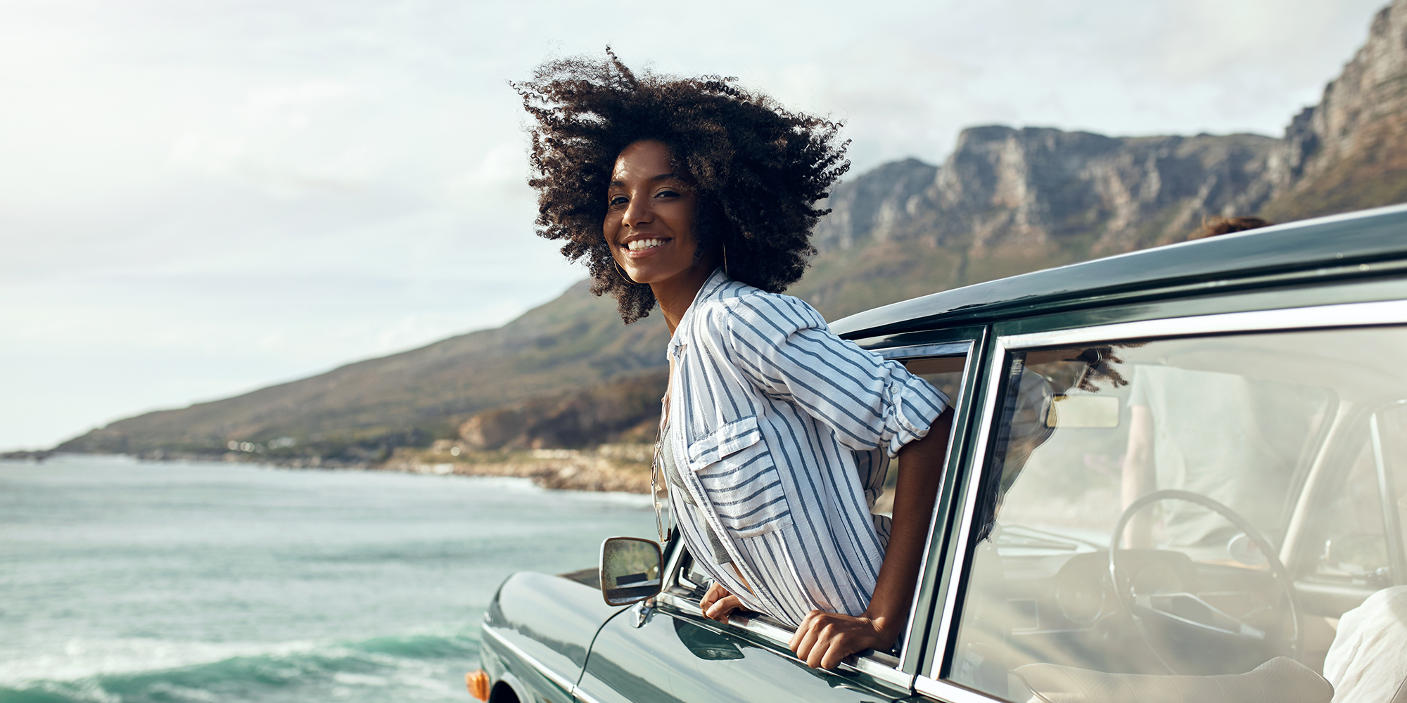 Woman hanging outside a car window - Upstart Personal Loans
