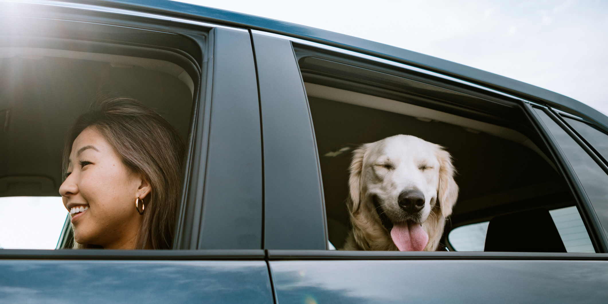 Woman in a car with her dog - Upstart Personal Loans